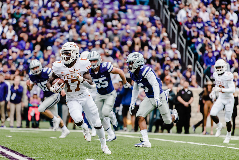 Wide reciever D'shawn Jamison runs past wildcat defenders during the game against Texas in Bill Snyder Family Stadium on Sept. 29, 2018. The Wildcats fell to the Longhorns 19-14. (Meg Shearer | Collegian Media Group)