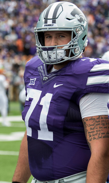 Senior offensive lineman, Dalton Risner stands in the middle of the stadium for the coin toss before the game against Texas on September 29, 2018 at Bill Snyder Family Stadium. (Sabrina Cline | Collegian Media Group)