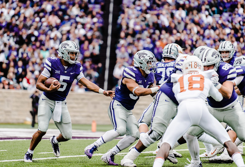 Quarterback Alex Delton, uses a stiff arm to try and gain more yards during the game against Texas in Bill Snyder Family Stadium on Sept. 29, 2018. The Wildcats fell to the Longhorns 19-14. (Meg Shearer | Collegian Media Group)