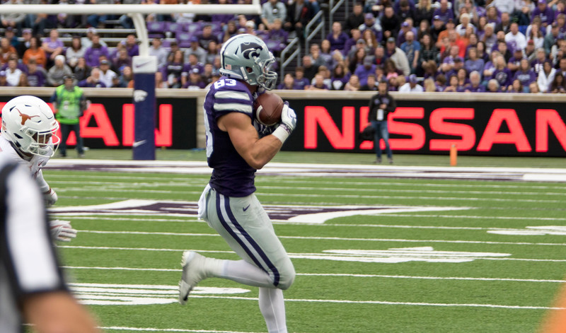 Junior wide receiver, Dalton Schoen catches the pass during the game against Texas on September 29, 2018 at Bill Snyder Family Stadium. (Sabrina Cline | Collegian Media Group)