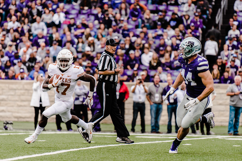 Wide reciever D'shawn Jamison tries to avoid wildcat defenders during the game against Texas in Bill Snyder Family Stadium on Sept. 29, 2018. The Wildcats fell to the Longhorns 19-14. (Meg Shearer | Collegian Media Group)