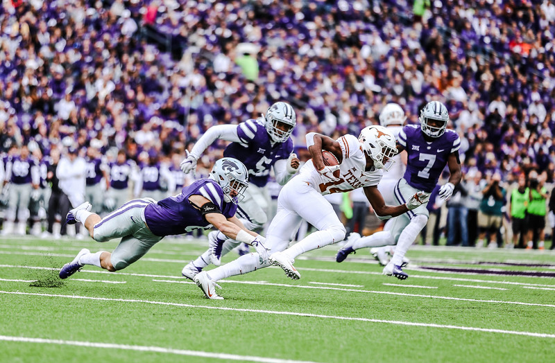 Wide receiver, Dalton Schoen, goes for a tackle during the game against Texas in Bill Snyder Family Stadium on Sept. 29, 2018. The Wildcats fell to the Longhorns 19-14. (Emily Lenk | Collegian Media Group)