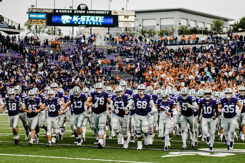 Wildcat family leaves the field together after game against Texas in Bill Snyder Family Stadium on Sept. 29, 2018. The Wildcats fell to the Longhorns 19-14. (Meg Shearer | Collegian Media Group)