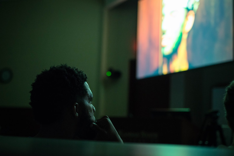 """A judge watches """"Coming into Cadence"""" during the K-State 48 Film Festival. """"Coming into Cadence"""" was produced by Flippin Film Co."""