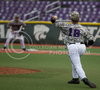Senior left hand pitcher, Parker Rigler, fields and throw the ball to first base during the K-State game against UC Riverside at Tointon Stadium on Mar. 12 2017. (Sabrina Cline | The Collegian)