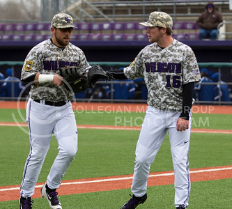 Senior left hand pitcher, Parker Rigler, high fives teammate, Jake Scudder after the play during the K-State game against UC Riverside at Tointon Stadium on Mar. 12 2017. (Sabrina Cline | The Collegian)
