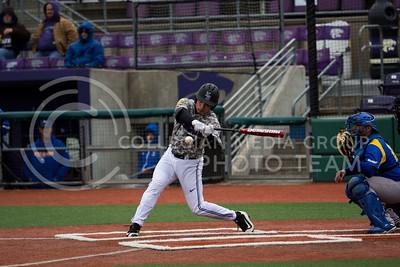 Sophomore catcher, Josh Rolette, makes contact during the K-State game against UC Riverside at Tointon Stadium on Mar. 12 2017. (Sabrina Cline | The Collegian)
