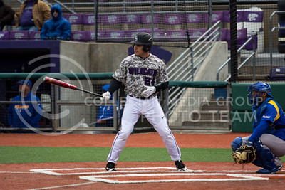 Sophomore catcher, Josh Rolette, gets set in the batter's box during the K-State game against UC Riverside at Tointon Stadium on Mar. 12 2017. (Sabrina Cline | The Collegian)