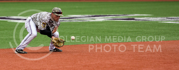 Senior shortstop, Jake Wodtke, fields the ground ball during the K-State game against UC Riverside at Tointon Stadium on Mar. 12 2017. (Sabrina Cline | The Collegian)