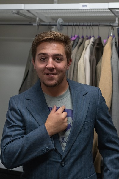 Carson Avery, sophomore in industrial engineering, poses with his new blazer from the Career Closet in the Berney Family Welcome Center. (Alex Todd | Collegian Media Group)