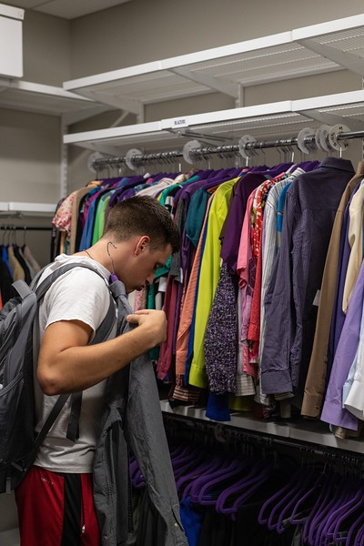 Sophomore in business administration, Ashton Cole, browses through the clothes available at the Career Closet. The Career Closet has a variety of clothing options for everyone and students are allowed to take three articles of clothing. (Alex Todd | Collegian Media Group)