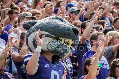 Willie Wildcat cheers with students against the Charlotte 49ers at Bill Snyder Family Stadium on Sept. 9, 2017. (Logan Wassall | Collegian Media Group)