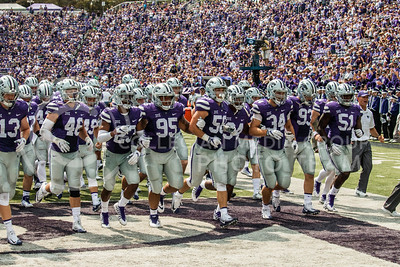 K-State Wildcats leave the field after the first half of their game against the Charlotte 49ers at Bill Snyder Family Stadium on Sept. 9, 2017. (Logan Wassall | Collegian Media Group)