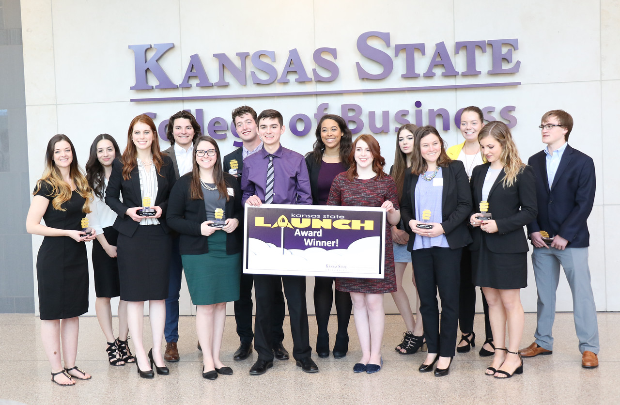 Finalists of K-State Launch gather for an award photo on Wednesday, March 14, 2018 in the College of Business Building. K-State Launch is an entrepreneurial idea competition for K-State students who have new venture ideas. Chris Zachary (back row, second from left), senior in entrepreneurship, won the grand prize of $2,000 for IRIS, which he described as a web platform for marketing video for professional services, such as real estate ventures. (Tiffany Roney | Collegian Media Group)