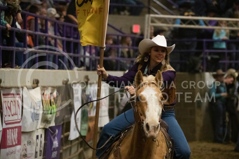 The Kansas State rodeo queens present the sponsors flags at Weber Arena at the 2020 Kansas State rodeo. (Dalton Wainscott | Collegian Media Group)