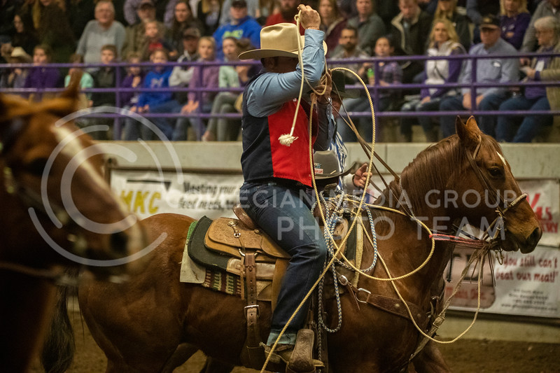 A calf roper rides out of the arena after an unsuccessful roping attempt at Weber Arena at the 2020 Kansas State rodeo. (Dalton Wainscott | Collegian Media Group)
