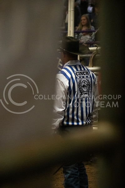A referee watches as the as the saddle bronc gets setup at Weber Arena at the 2020 Kansas State rodeo. (Dalton Wainscott | Collegian Media Group)