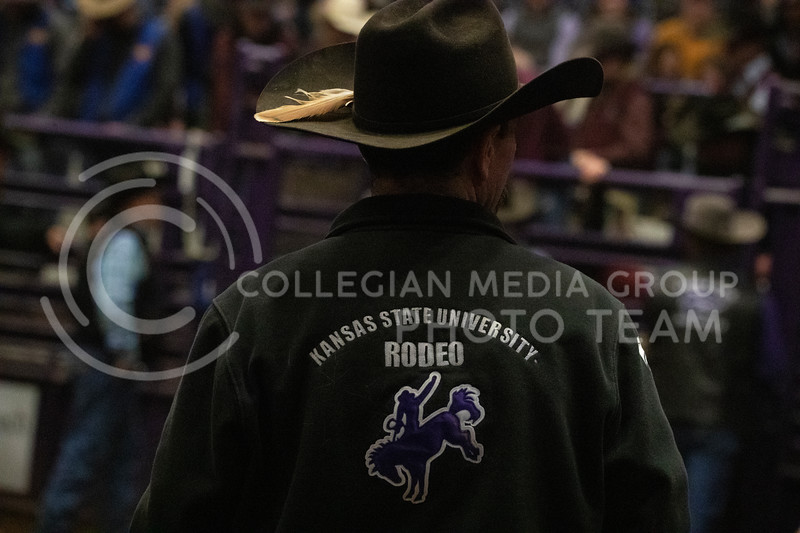 Rodeo club advisor Casy Winn watches as the bareback riders get setup. Winn was later injured during the bull riding portion of the rodeo at Weber Arena at the 2020 Kansas State rodeo. (Dalton Wainscott | Collegian Media Group)