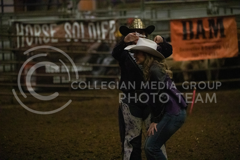 The new rodeo queen is crowned by the former rodeo queen at Weber Arena at the 2020 Kansas State rodeo. (Dalton Wainscott | Collegian Media Group)