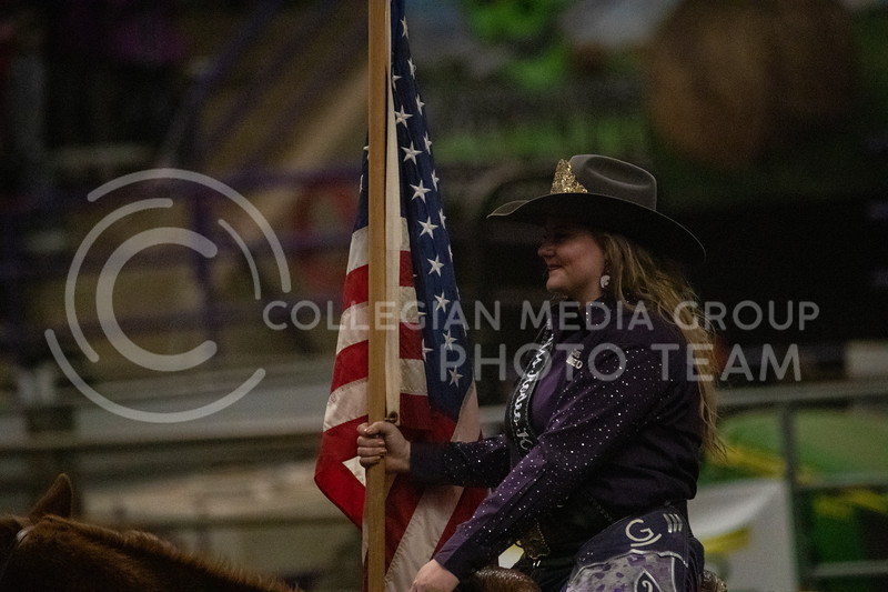 Miss Rodeo K-State rides around the arena and presents the American flag at Weber Arena at the 2020 Kansas State rodeo. (Dalton Wainscott | Collegian Media Group)