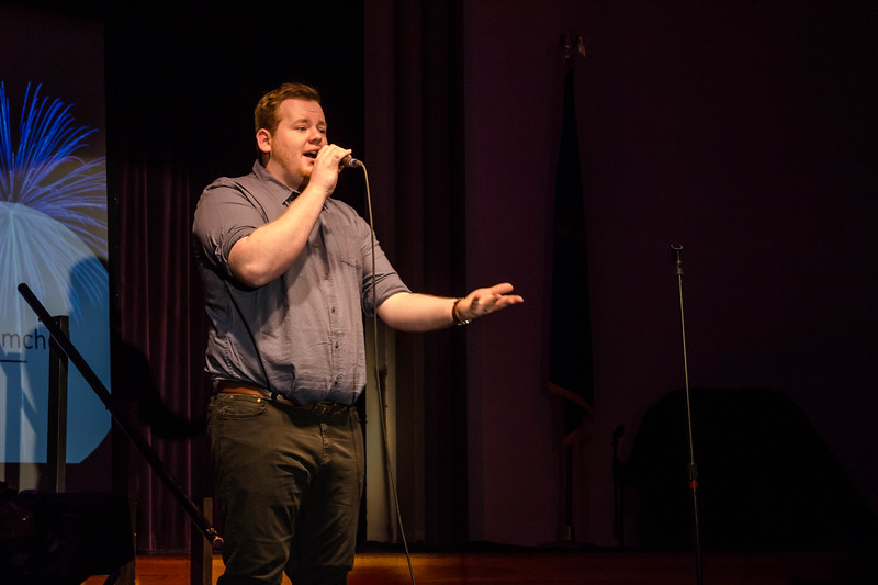 Ian Reimschisel, sophomore in Interior Architecture & Product Design, performs an upbeat song that wows the judges at Union Program Council's annual K-State Voice competition.