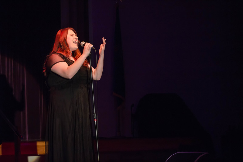 McKennzie Duncan, sophomore in Animal Sciences, captivates the audience with a heartfelt performance at Union Program Council's annual K-State Voice competition.
