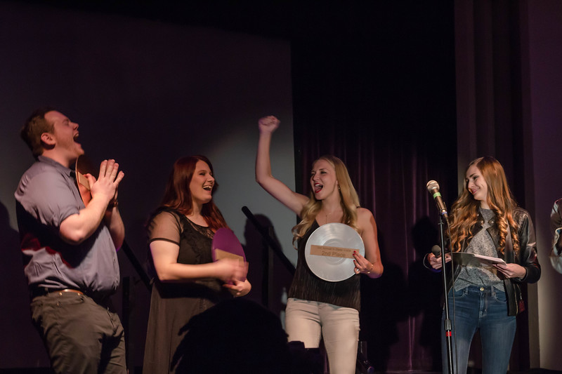 First place winner, McKennzie Duncan, is congratulated by second place winner, Abigail Lane, and third place winner, Ian Reimschisel, at Union Program Council's annual K-State Voice competition.