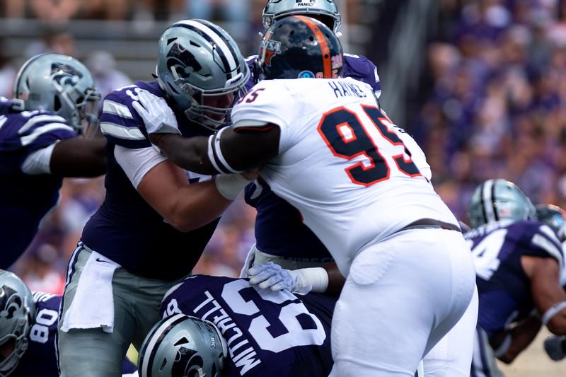 "Blocking Sophmore Jaylon Haynes, Kansas State Lineman  Adam Holtorf defends Quarterback Skylar Thompson. The 6'4"" Junior from Nebraska started every game last year and continues to do so as his talent develops.  (Rowan Jones   Collegian Media Group)"