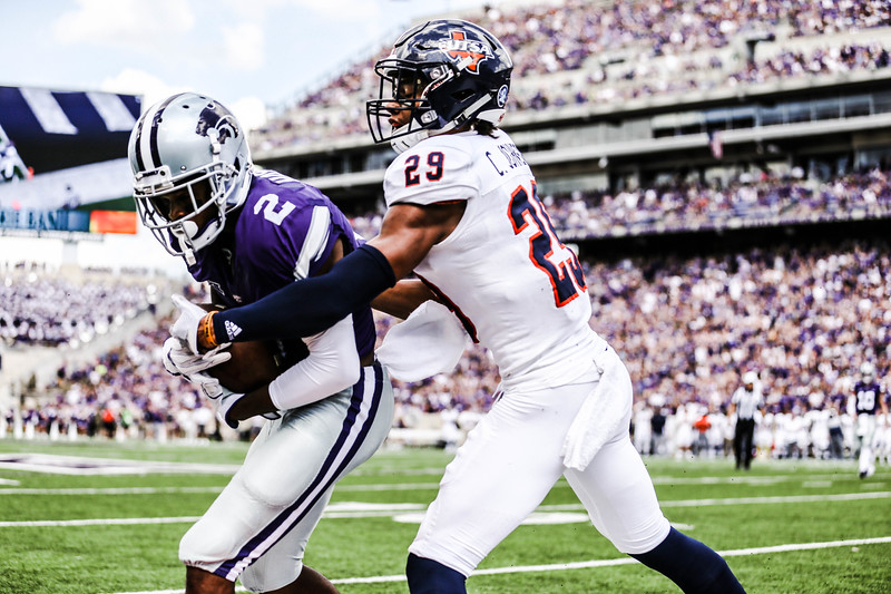 Isaiah Harris tries to hold onto the ball during the game against UTSA. The Wildcats ended the game with a score of 41-17, which was their second win of the 2018 season (Emily Lenk   Collegian Media Group)