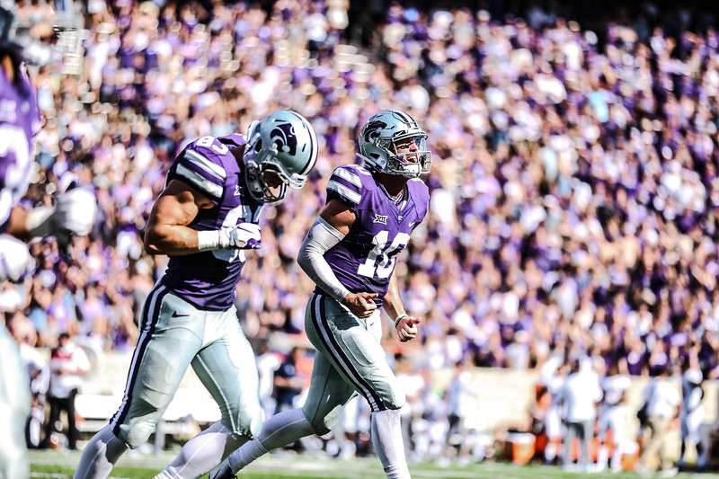 Blake Lynch, 10, express excitement after a touchdown during the game against UTSA at Bill Snyder Family Stadium on Saturday. (Emily Lenk   Collegian Media Group)