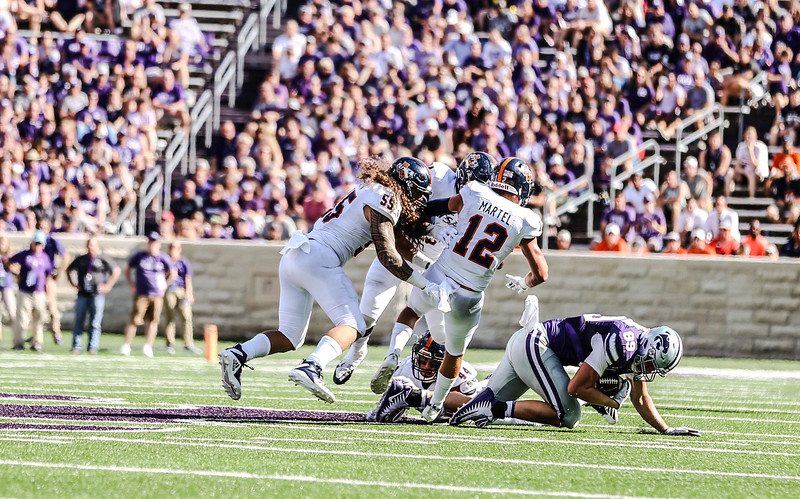 Blaise Gammon holds onto the ball during the game against UTSA. The Wildcats ended the game with a score of 41-17, which was their second win of the 2018 season (Emily Lenk   Collegian Media Group)