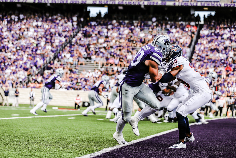 Dalton Schoen goes up against UTSA player #29 during the game against UTSA. The Wildcats ended the game with a score of 41-17, which was their second win of the 2018 season (Emily Lenk   Collegian Media Group)