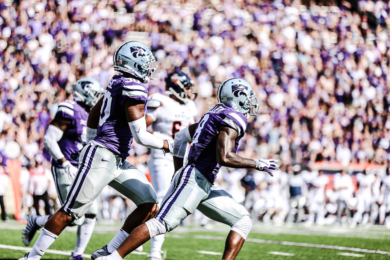 Bronson Massie and Duke Shelly take off running during the game against UTSA. The Wildcats ended the game with a score of 41-17, which was their second win of the 2018 season (Emily Lenk   Collegian Media Group)