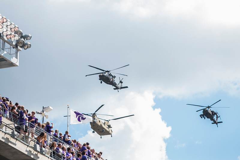 Fort Riley performs a flyover during the national anthem before the football game against UTSA in Bill Snyder Family Stadium on Sept. 15, 2018. The Roadrunners fell to the Wildcats 41-17. (Logan Wassall   Collegian Media Group)
