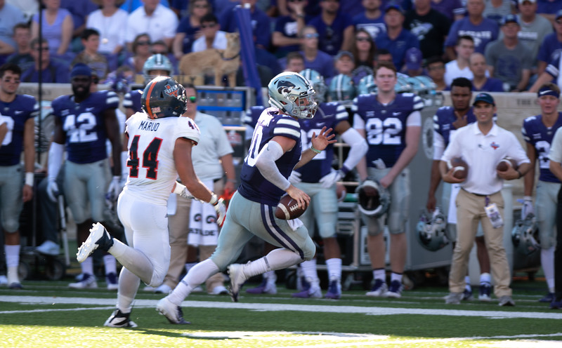 Being pursued by free safety C.J Levine Kansas State quarterback Skylar Thompson runs the ball for a first down. Thompson had 13 completed passes and had 2 passing touchdowns against UTSA (Rowan Jones   Collegian Media Group)