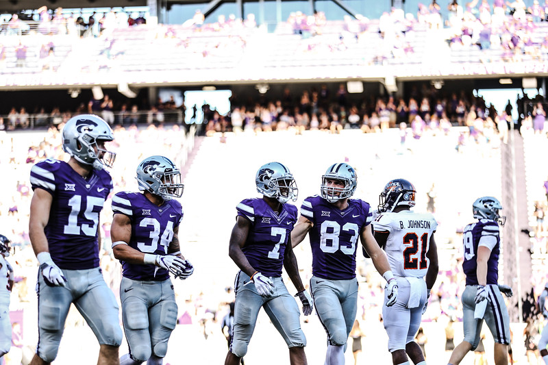 Players 15, 34, 7, and 83 celebrate after a touchdown during the game against UTSA at Bill Snyder Family Stadium on Saturday. (Emily Lenk   Collegian Media Group)