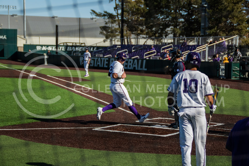 Dylan Phillips, sophomore, runs to the home plate for Kstate's second run to take the lead 2-1 to end 3rd innings. (Sreenikhil Keshamoni | Collegian Media Group)