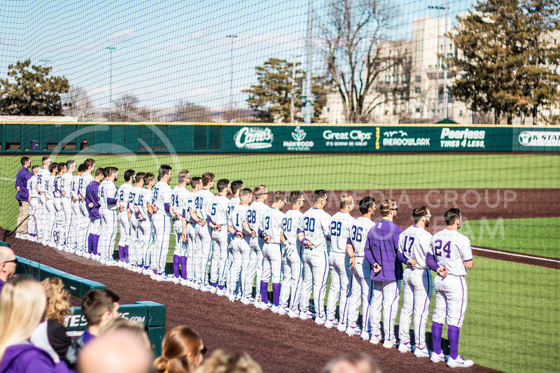 KSU baseball team standing on the field for the National Anthem on feb 28th while playing against Fairleigh Dickinson. (Sreenikhil Keshamoni | Collegian Media Group)