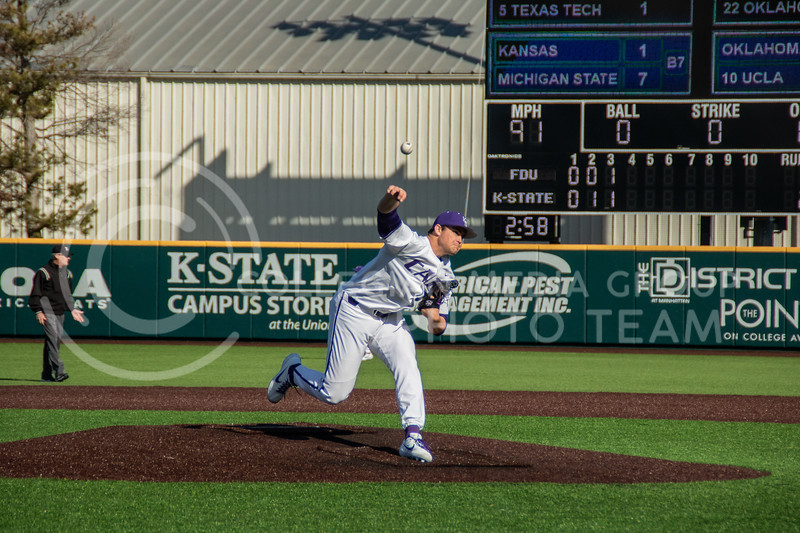 Carson Seymur, red shirt, sophomore, pitched the last the strike out to end the 4th innings. K-State still leading 2-1. (Sreenikhil Keshamoni | Collegian Media Group)