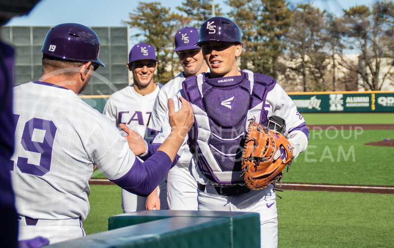 Mason Crews(36, sophmore) congratulating Carson Seymur, the red shirt sophomore as they walk to the dugouts with the catcher,  Dylan Caplinger(junior) shakes Pete Hughes (K-State's Head coach) hand.(Sreenikhil Keshamoni | Collegian Media Group)