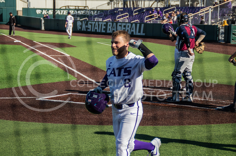 Cameron Thompson, senior, at the home plate celebrating after hitting the first homerun of the game. Now K-State takes lead of 4-1. (Sreenikhil Keshamoni | Collegian Media Group)