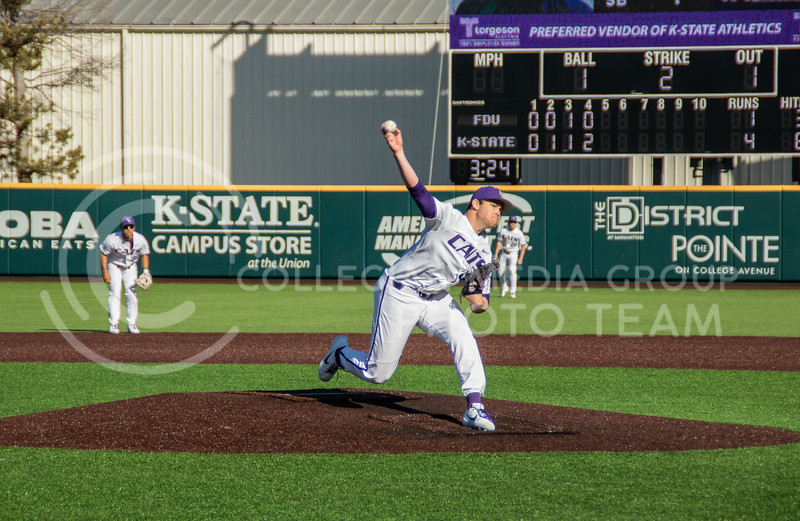 Carson Seymur, red shirt sophomore, pitching the last strike out to end the top of 5th innings with k-state leading 5-1. (Sreenikhil Keshamoni | Collegian Media Group)