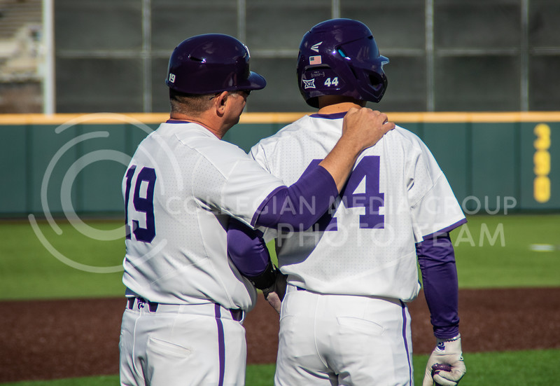 Pete Hughes, head coach for K-State's baseball team, giving pointers to Dylan Caplinger, junior, who is up to bat next. (Sreenikhil Keshamoni | Collegian Media Group)