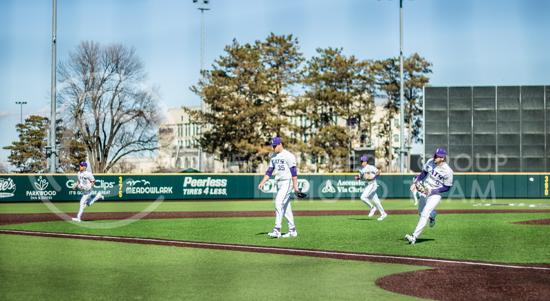 Wildcats walking to the dug out after end of top of the first innings. (Sreenikhil Keshamoni | Collegian Media Group)