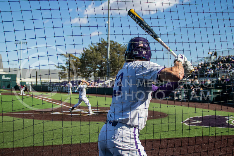 Caleb Littlejim, senior, on deck getting ready to bat in the 4th innings as K-State is still up 2-1. (Sreenikhil Keshamoni | Collegian Media Group)