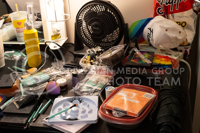 a table of disorganized products backstage for members of the show to use to get ready at McCain Auditorium, which will host its 16th Drag Show at 7 pm on February 14th 2020. ( Dalton Wainscott | Collegian Media Group)