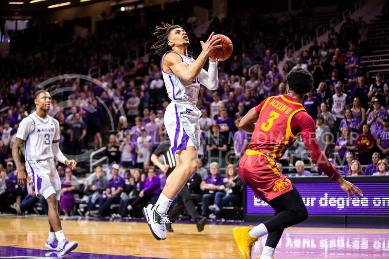 Junior guard Mike McGuirl charges the basket during K-State's Senior Day Saturday game against Iowa State in Bramlage Coliseum on March 7, 2020. The Wildcats took the Cyclones 79-63. (Logan Wassall | Collegian Media Group)