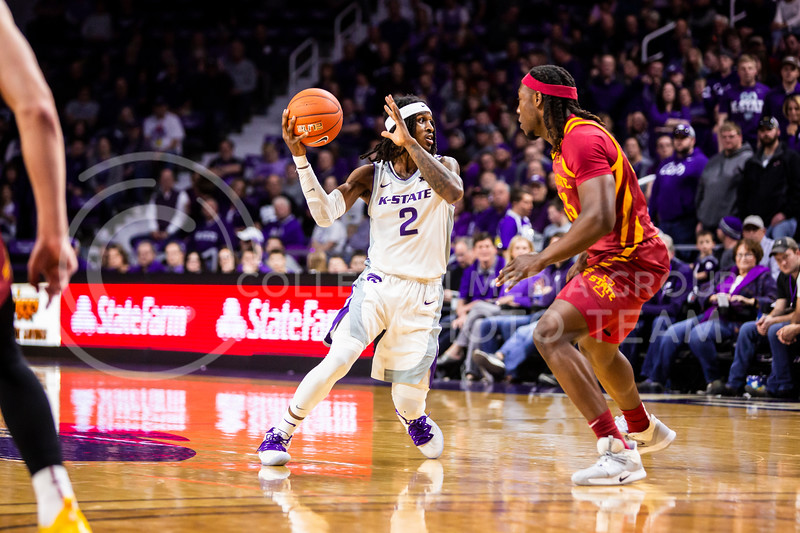 Junior guard Cartier Diarra scans the court for an open play during K-State's Senior Day Saturday game against Iowa State in Bramlage Coliseum on March 7, 2020. The Wildcats took the Cyclones 79-63. (Logan Wassall | Collegian Media Group)