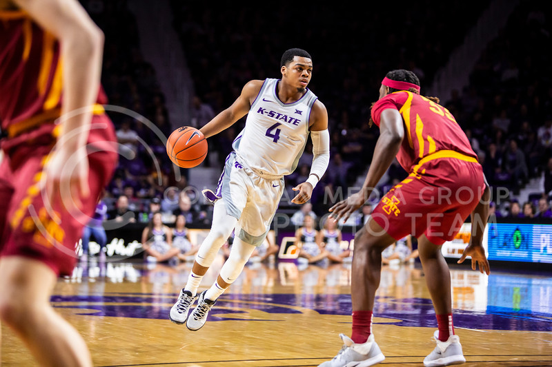 Junior guard David Sloan scans the court for an open play during K-State's Senior Day Saturday game against Iowa State in Bramlage Coliseum on March 7, 2020. The Wildcats took the Cyclones 79-63. (Logan Wassall | Collegian Media Group)