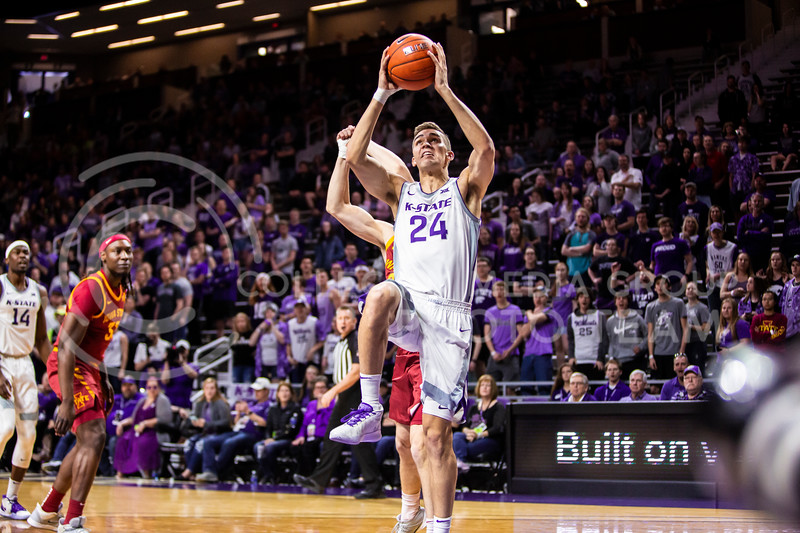 Senior forward Pierson McAtee leaps dowards the basket for a dunk during K-State's Senior Day Saturday game against Iowa State in Bramlage Coliseum on March 7, 2020. The Wildcats took the Cyclones 79-63. (Logan Wassall | Collegian Media Group)